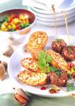 Deftige Ofenkartoffeln mit leckeren Mandeln und Hackbällchen