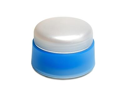Blauer Cremetiegel mit weißem Deckel.